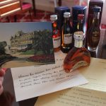 An old post card, some letters, and miniature Martell bottles